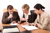 stock photo of business meetings  - group of business people working at the desk - JPG