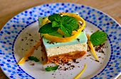 Cheesecake Slice. Slice Of Cheesecake On Blue Plate. Homemade Cheesecake Piece With Lemon & Mint For poster