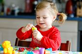 Adorable Cute Little Toddler Girl With Colorful Clay. Healthy Baby Child Playing And Creating Toys F poster