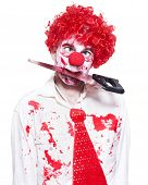 Spooky Clown Holding Bloody Saw In Mouth On White