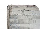 pic of payroll  - Old Time Record and Payroll in an archived with dust dated 1976 isolated in whiye background - JPG