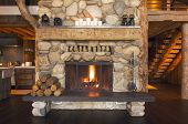 stock photo of log cabin  - Rustic Fireplace in Beautiful new Log Cabin - JPG