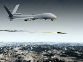 stock photo of drone  - Drone aircraft launching an air to ground missile - JPG