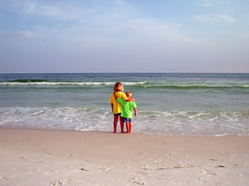 image of children beach  - brother and sister admiring ocean - JPG