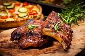 stock photo of flame-grilled  - BBQ spare ribs with herbs - JPG