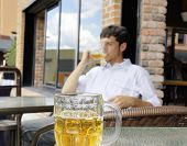 image of bing  - Young man drinking beer focus on front glass bock - JPG