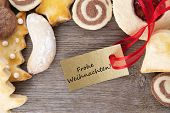 stock photo of weihnachten  - a christmas cookie background with the german words Frohe Weihnachten which means merry christmas - JPG