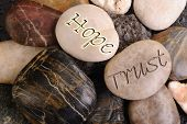 picture of sympathy  - Hope and trust stones in an open rock formation - JPG
