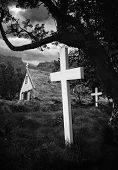 old Iceland church and cemetery grass roof building and white crosses in graveyard beautiful traditi