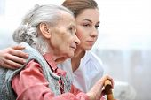foto of lonely woman  - Senior woman with her caregiver at home - JPG