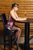 image of single woman  - Young beautiful woman sitting in the cafe with a glass of wine - JPG