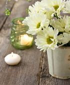 stock photo of chrysanthemum  - Bouquet of white chrysanthemums in a vase on a wooden background - JPG
