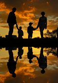 pic of family fun  - family of four sunset 2 and water - JPG