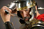 foto of armor suit  - Menacing Roman soldier holding sword - JPG
