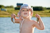 stock photo of fish pond  - Boy  - JPG