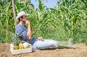 image of hoe  - Farmer relaxing on a hoe in a field after collecting fruits and vegetables - JPG