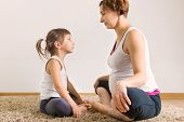 pic of physical education  - Young pregnant woman with little daughter doing yoga exercises - JPG