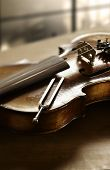 image of tuning fork  - Still life photography of violin and tuning fork - JPG