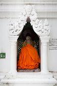 image of yangon  - A Buddhist monk prays at Shwedagon Pagoda in Yangon Myanmar - JPG