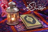 picture of quran  - A beautiful image of Ramadan lantern beside Quran with text Ramadan Kareem in Arabia - JPG