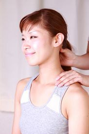 picture of nacked  - woman getting a neck massage in the massage office - JPG