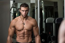 stock photo of bicep  - Fit Athlete Working Out Biceps  - JPG