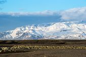 stock photo of snow capped mountains  - scenic landscape of southern Iceland - JPG