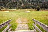 image of old bridge  - an old wooden bridge on an idyllic meadow or a beautiful golf course - JPG