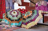 stock photo of flea  - Colorful ethnic umbrellas with decorations on Rajasthan flea market in India - JPG