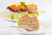 image of iceberg  - Salty cake made from pancakes tuna fish eggs carrots olives and iceberg salad - JPG