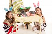 pic of three sisters  - Three sisters with Easter bunny ears and eggs - JPG