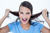 image of pulling hair  - Furious woman pulling her hair on background - JPG