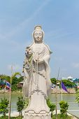stock photo of yin  - the white stone carving for Guan Yin statue with sky background - JPG