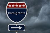 stock photo of citizenship  - Immigrants this way sign Blue Red and White highway sign with words Immigrants with stormy sky background - JPG