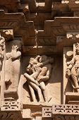 stock photo of kamasutra  - Stone carved erotic sculptures on temple - JPG