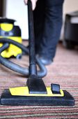 image of maids  - Maid cleaning the carpet with vacuum cleaner  - JPG