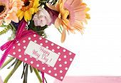 picture of vase flowers  - Happy May Day Gift Of Spring Flowers In Vase on pink wood table with greeting card - JPG