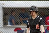 stock photo of infield  - A female fastpitch softball player in the batters box - JPG