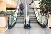 picture of escalator  - The man on the escalator at the mall - JPG