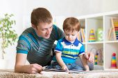 image of pretty-boy  - kid boy and his dad read a book together - JPG