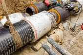 image of pipe-welding  - Welder is lie donw in trench until welding huge pipeline - JPG