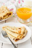 foto of crepes  - Thin Pancakes with Orange Sauce (Crepe Suzette) copy space for your text ** Note: Shallow depth of field - JPG