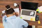 image of boredom  - High Angle View Of Businesswoman Doing Head Down On Desk - JPG