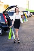 picture of shopping center  - Woman after shopping in a mall or shopping centre and driving home now with her car - JPG