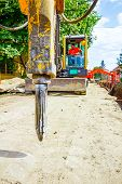image of hydraulics  - Excavator has attached hydraulic plug - JPG
