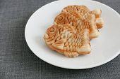 pic of plate fish food  - Japanese confectionery taiyaki fish cake wagashi on plate - JPG