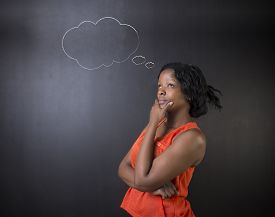 pic of teachers  - South African or African American woman teacher or student thinking with thought clouds - JPG