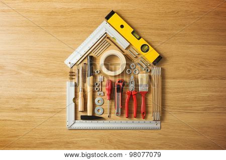 Do it yourself and home renovation tools poster id98077079 conceptual house composed of diy and construction tools on hardwood flooring top view poster id 98077079 solutioingenieria Gallery