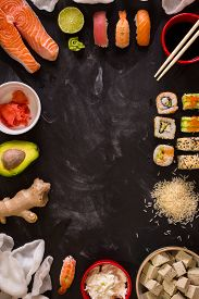 image of soy sauce  - Overhead shot of sushi and ingredients on dark background - JPG
