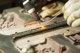 foto of tig  - Welding work by TIG welding to repair mold - JPG